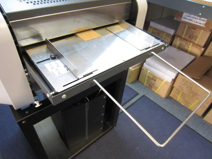 Adjustable Feed Tray on ALM Automatic Laminator